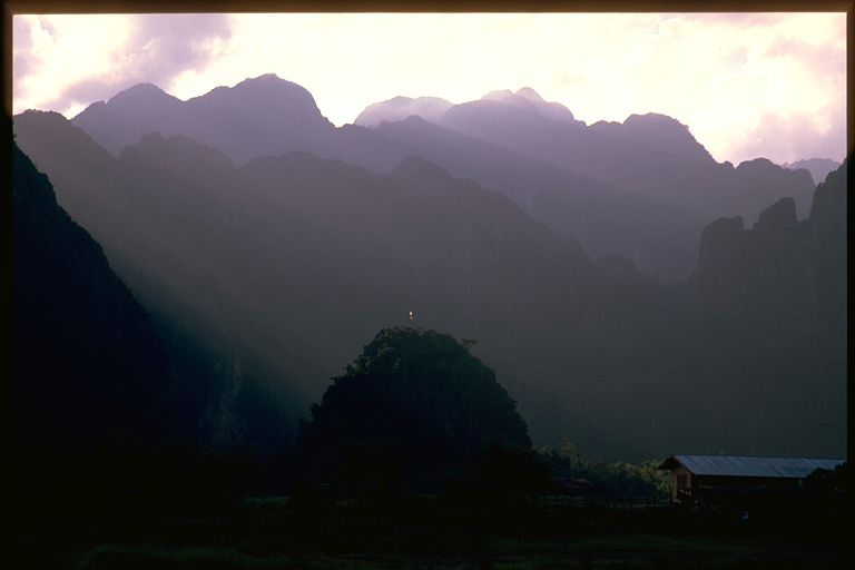 Vang Viene sun bursts thru clouds, Laos
