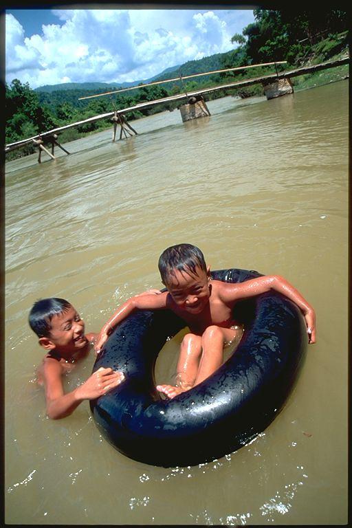 Boys tubing in Mekong River Vang Viene, Laos