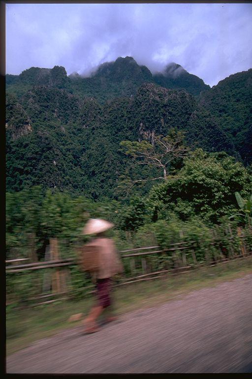 Man walking on roadside, Laos