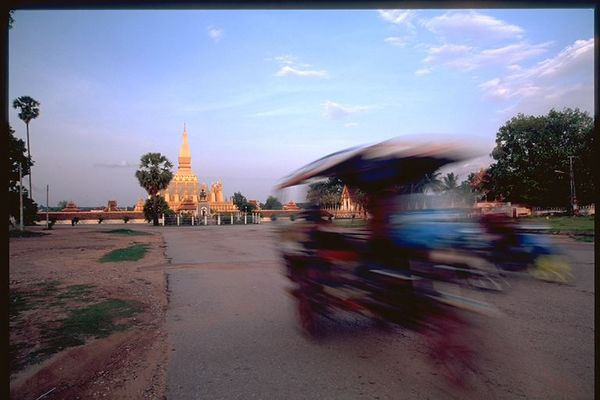 Tuk Tuk speeding by near Wat Vientiane, Laos