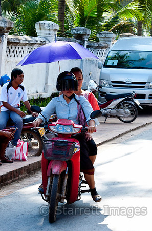 Parasol while riding a motorbike