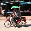 Motorcyclist with green parasol, Luang Prabang. Riding with parasols seems to be pretty common in Laos.