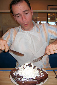 Bro-in-law Dwanye digs into chocolate pancakes at a local IHOP