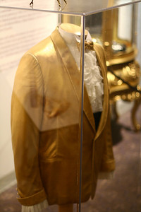In his Liberace's early career, this gold jacket and ruffles was probably considered showy...