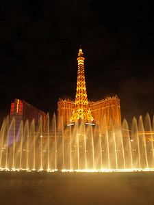 The Bellagio Fountains shooting up in front of the Eiffel Tower in Las Vegas  Order Code: A11