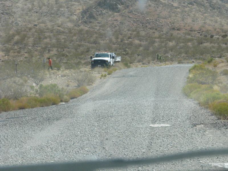 A road crew filling potholes.