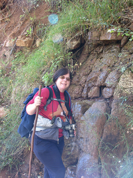 Julie standing by a leaking rock.