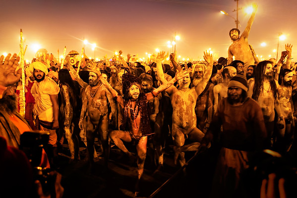 After the dip, the spirits are high, they bathe, they dance, they are still naked. These are the Juna Akhara Sadhu, they cover themselves in ashes and are always almost naked.