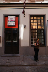 The Attaché was not aware I took this picture, nor was she aware of the sign.  The store was actually a legit clothing store.