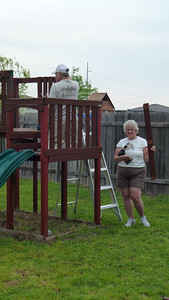 Mom helping Dad with the playset.