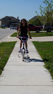 Ashley riding her bike that she got for Christmas.