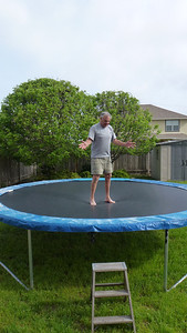 Dad on the trampoline. He could barely stand on it without falling over.