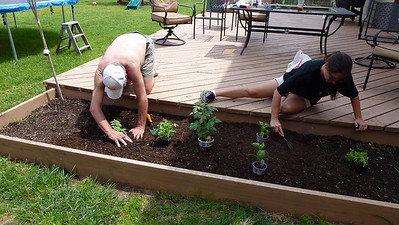 Dad and Deb planting her garden.