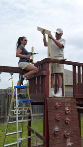 Deb and Dad working on the roof to the playset.