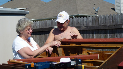 Mom and Dad working on the roof to the little house in the back of Deb's yard.