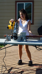 Debbie working the table saw.