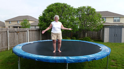 Mom on the trampoline.
