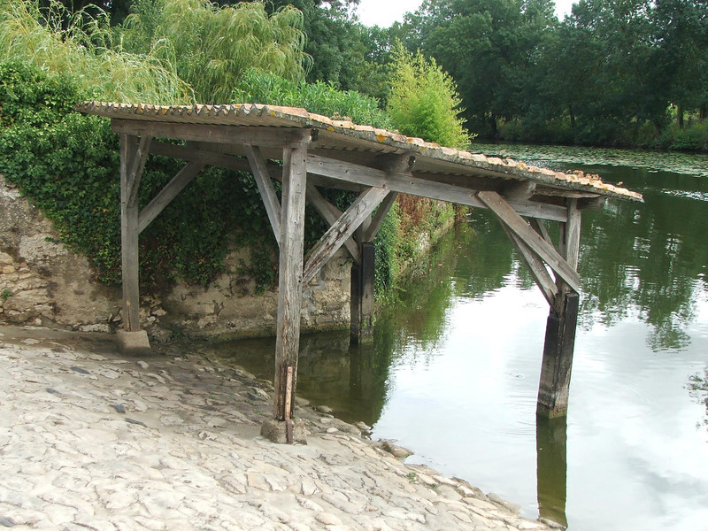 This lavoir is purely a shelter to keep the sun off the people washing their clothes in the river.