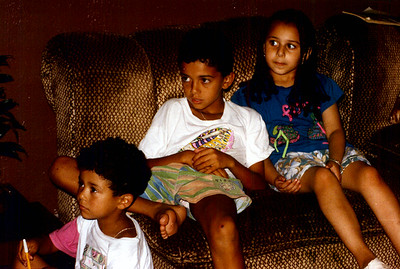 Zineb, Saad and Mehdi watching cartoons.