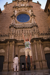 Leanne tries to touch the heavens, an old tradition at the monastery.