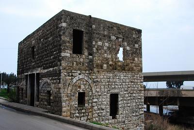 War damaged (June '06) building at the entrance to Dog River