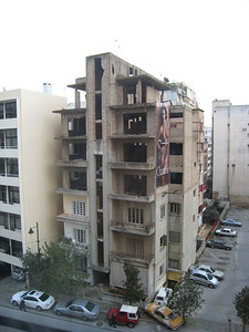 The apartment block opposite our hotel, still showing bomb damage.