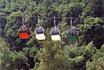 The gondolas that carry visitor to the upper chamber at Jeita
