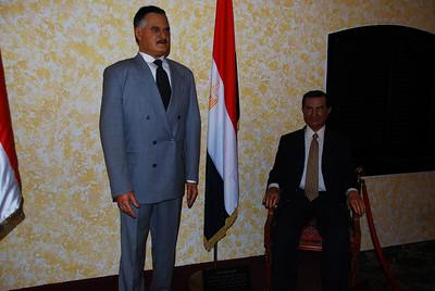 General Nasser looking very grumpy.  President Mubarek looks vaguely amused.
