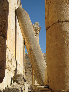 Fallen column leaning against the side wall of the Temple of Bacchus