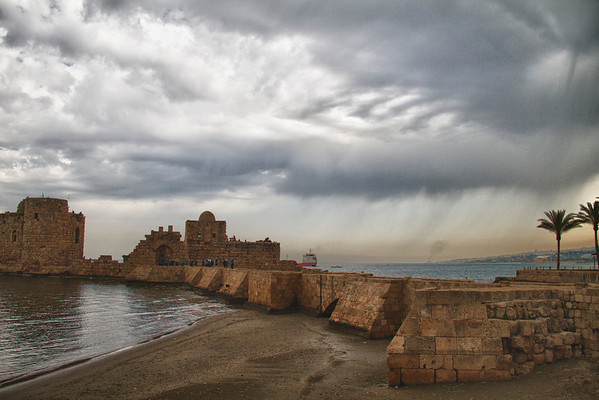 Sidon sea castle (in the rain)  Sidon Sea Castle (Arabic: قلعة صيدا البحرية Kalaat Saida al-Bahriya) is a castle in Sidon, Lebanon. It was built by the Crusaders in 1228 on a small island connected to the mainland by a causeway. A climb to the top leads to the roof where there is a good view of the port and the old part of the city.
