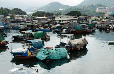This is an area in Hong Kong that I never knew about.  Lots of people live on these boats or in the surrounding shacks.