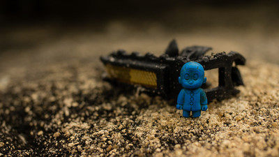 """There is a lot of """"junk"""" along the beach.  Found this partial bike pedal and employed the blue guy."""