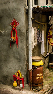 There are endless little alleys.  Just about anywhere you can find some combination of laundry, offerings to the gods, and fuel.  :)