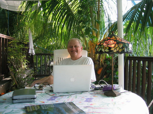 On the laptop at the Auberge. Getting our photos transferred to the fixed disk then to CD at the Auberge des Petites Saintes was pleasant.