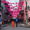 The wife of the Governor decorated this street with umbrellas, then changed them all to pink to honor womens' issues.