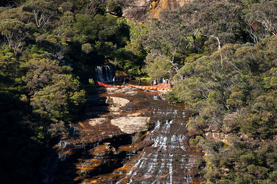 Walkers cross the top of Wentworth Falls