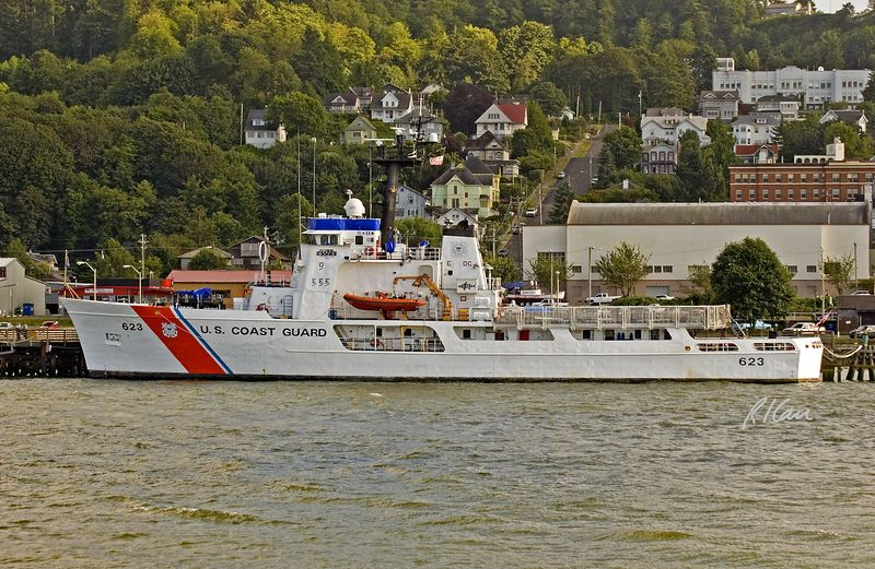 Coast Guard Cutter/Ship: United States Coast Guard Reliance Class Patrol Cutter STEADFAST (WMEC) 623 was commissioned in 1968. She is now homeported in Astoria, Oregon where the great Columbia River meets the Pacific Ocean in the most dangerous ocean/river entry in the world. The STEADFAST is 210.5 ft long and 34 ft wide with 10.5 ft draft, and it displaces 1,050 tons. She is propelled by 2 diesels with 2 shafts/propellers with 5,000 bhp and 18 knot speed, and she has a helicopter deck at midships (area surrounded by railing/net). She carries a crew of 62. Astoria, Oregon 2005.