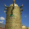 A bell or monument or something, on top of the Jokhang Monastery.