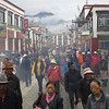Pilgrims and locals circumambulate the Jokhang Monastery on the Barkhor route amidst clouds of incense.