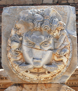 Leptis Magna: Medusa medallion, Roman forum Medusa, with her snake-infested hair, turned to stone anyone who gazed upon her. Romans considered her a protectress and displayed her image around important public areas, such as the forum.