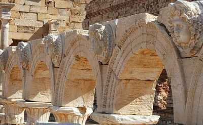 Leptis Magna: New forum, arch fragments with Medusa medallions The forum was ordered built by the Roman emperor Septimius Severus, who was born at Leptis Magna, It replaced an older forum closer to the seashore.