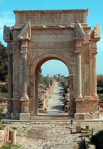 Leptis Magna: Arch of Septimius Severus (modern restoration with original fragments, 3rd century A.D.) Septimius Severus, a Roman emperor, was born in Leptis Magna. Leptis is Libya's Pompeii, minus the volcanic preservation, a well-preserved Roman metropolis about thirty miles west of Tripoli. Buried under the Roman city is the original, and smaller, Phoenician settlement of the 7th century B.C.
