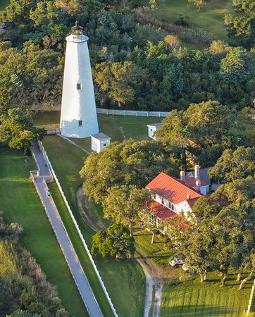 """""""Okracoke Lighthouse""""  The island of Ocracoke is a part of the Outer Banks of North Carolina. It is one of the most remote islands in the Outer Banks, as it can only be reached by one of three public ferries (two of which are toll ferries), private boat, or private plane. Other than the village of Ocracoke and a few other areas (a ferry terminal, a pony pen, a small runway), the entire island is part of the Cape Hatteras National Seashore"""