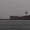 Portsmouth Harbor Light in foreground with Whaleback Lighthouse in distance.