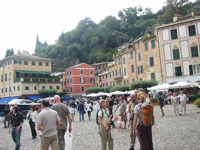 One of the Kiwis, our guide Alessandro, and Arah, at right, in Portofino Piazza.