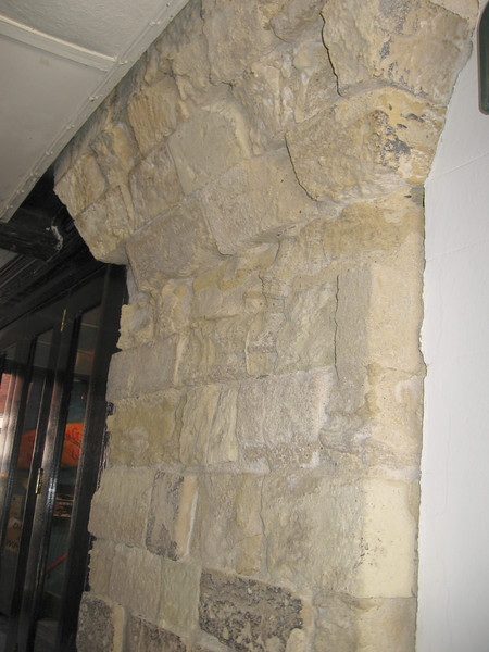Stones from the palace built by William the Conqueror in Winchester reused in a chimney.