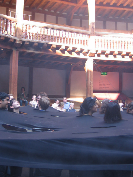 The audience at the Globe Theater before the jerformance of Macbeth. The effect was supposed to be of disembodied heads