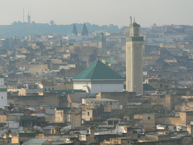 Looking through haze across the roofs of old Fez from the top of Riad Dar Masmoudi