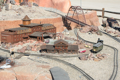 11/13/05  LGB Model Train Display. The Living Desert Zoo & Gardens, Palm Desert, Riverside County, CA.  Currently there are more than 2,300 feet of track laid including the European and Western sides of the railroad along with all the side tracks and storage area. With three loops of track, each about 150 feet long, the railroad has grown to an acre with five distinct inner connected layouts. The mainline train travels on 980 feet of track and runs through Old Indio, past the Grand Canyon and along side the mining and logging areas. The trains are driven into a tunnel each night in an opening under the European Alps mountain building. The building is a workshop and storage facility measuring approximately 36 by 14 feet.