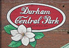 'Durham Central Park' sign on brick wall
